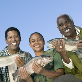 Family Holding Fish